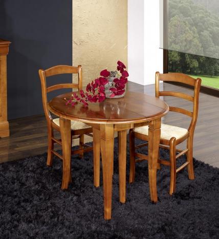 Mesa de comedor redonda extensible y con alas abatibles fabricada en madera de cerezo macizo al estilo Louis Philippe con 3 extensiones de 40cm